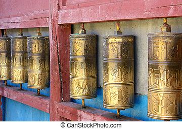 Row of buddhist prayer wheels in Gandan Monastery, Mongolia