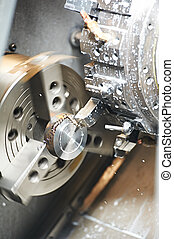 metal blank machining process on lathe with cutting tool and...