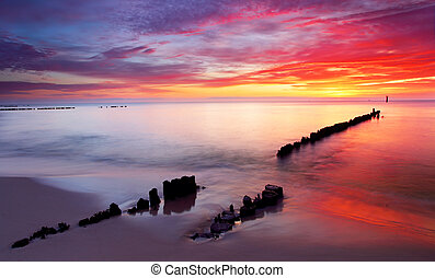 Baltic sea at beautiful sunrise in Poland beach
