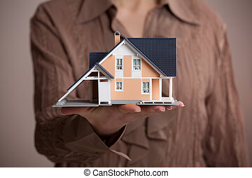 House - Real estate agent offer house represented by model.
