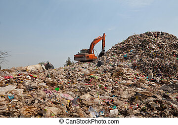 Backhoe at garbage dump