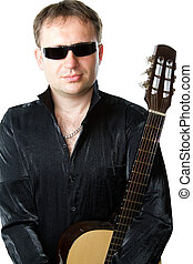 Guitarist man and acoustic musical instrument six-string...