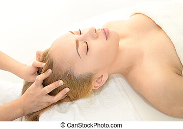 Woman having massage - Woman in spa salon receives head...