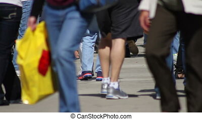 Feet on Crowded Pavement - The feet of dozens of pedestrians...