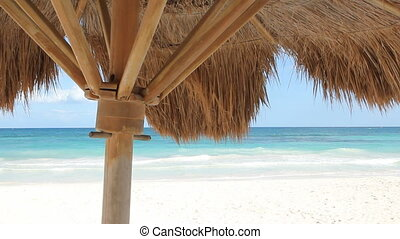 Palapa at the beach. - Beach view from underneath a palapa....