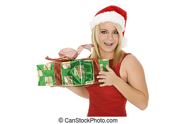 Christmas - Beautiful Caucasain female holding gifts on...