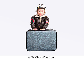 Little boy with suitcase over white