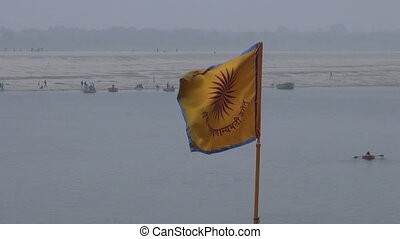 hinduism ceremony flag on Ganges river coast in...