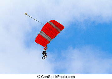 Skydiver Parachute Open - A person skydiving with their...