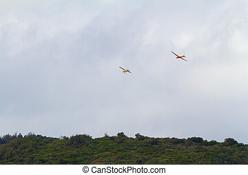 Glider Plane Take-off - A glider is being towed by another...