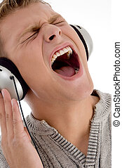 shouting man with headphone against white background