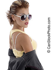 side view of young female posing with eyeglasses and jacket...