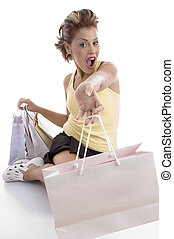 sitting sexy woman showing shopping bags - sitting sexy...