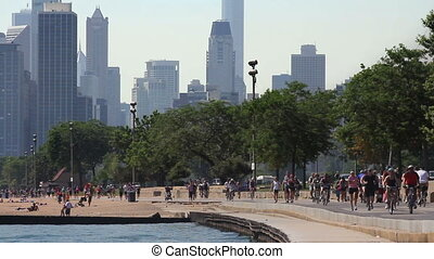 Path and City Skyline - Runners and cyclists on the...