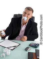 frustrated businessman with paper in his mouth