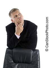 thinking businessman with chair