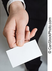 Hand Holding Business Card - Close up of the hand of a man...