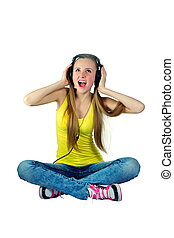 girl in headphones listens to music and laughs - a girl in...