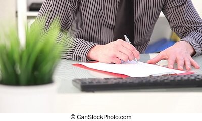 Businessman writing notes, close up