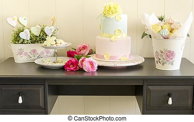 cookies, wedding cake and meringues - Exhibitor table with...