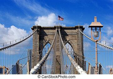 Brooklyn Bridge and American flag