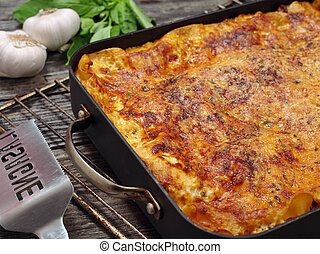 Lasagna - Photo of a freshly baked lasagna, sitting on an...