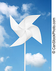 toy windmill over blue sky