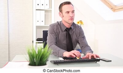 Businessman typing on a keyboard an