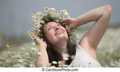Happy pregnant woman in camomile