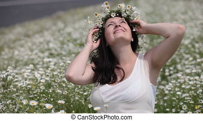 pregnant woman in camomile field - Happy pregnant woman in...