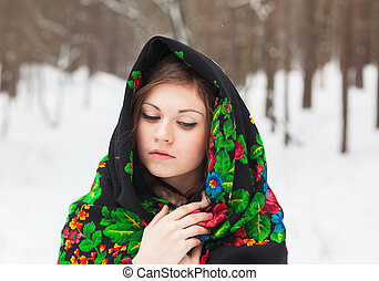 beautiful girl in a cloth with patterns