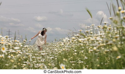 Pregnant woman in spring field - Pregnant woman walking...