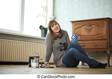 Attractive Young Woman Relaxing with Tea