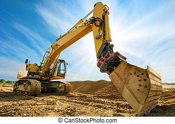 Big excavator in front of the blue sky - Big excavator on...