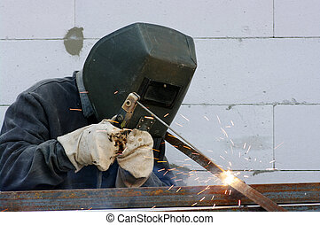 welder worker welding metal Bright electric arc and sparks