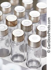 Close-up little laboratory flasks in cartridge