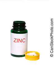 zinc tablets - close-up of zinc jar and tablets isolated on...