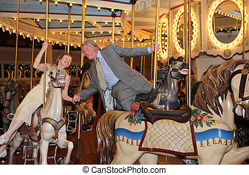 Merry-Go-Round Romance - An active mature couple enjoying a...