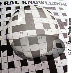 glass ball on crossword puzzle - an illustartion of a glass...