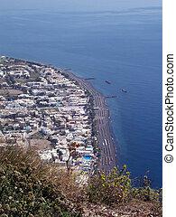 Kamari village on Santorini - A sunkissed view of the...