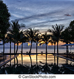 Luxury infinity pool at sunset