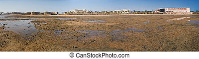 The tide is out at the beach in Hurghada, Egypt