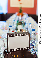 Movie film sign for a wedding dinner table