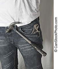 Workman in denims - An image of working man in jeans with...