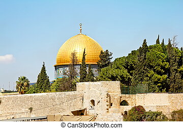 The golden dome of the rock mosque in Jerusalem against the...