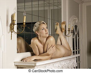 Woman on the fireplace without any clothes