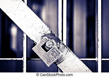 Padlock on the cell door of a prison in black and white -...