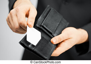 man in suit holding credit card - man in suit with wallet...