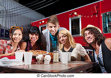 Friends Smiling Near Food Truck