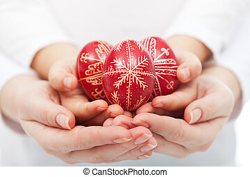 Woman and child hands holding easter eggs - Woman and child...